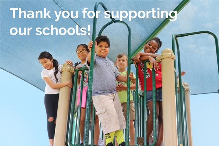 Thank you for supporting our schools!  (picture of students on playground)