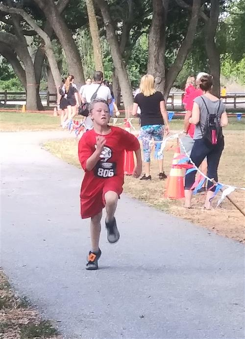 boy running to finish line